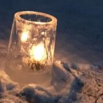 candle within an ice holder