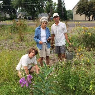 three people in a pollinator garden