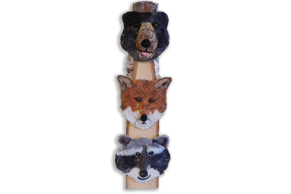 felted mask of bear, fox and racoon mounted on birch slab