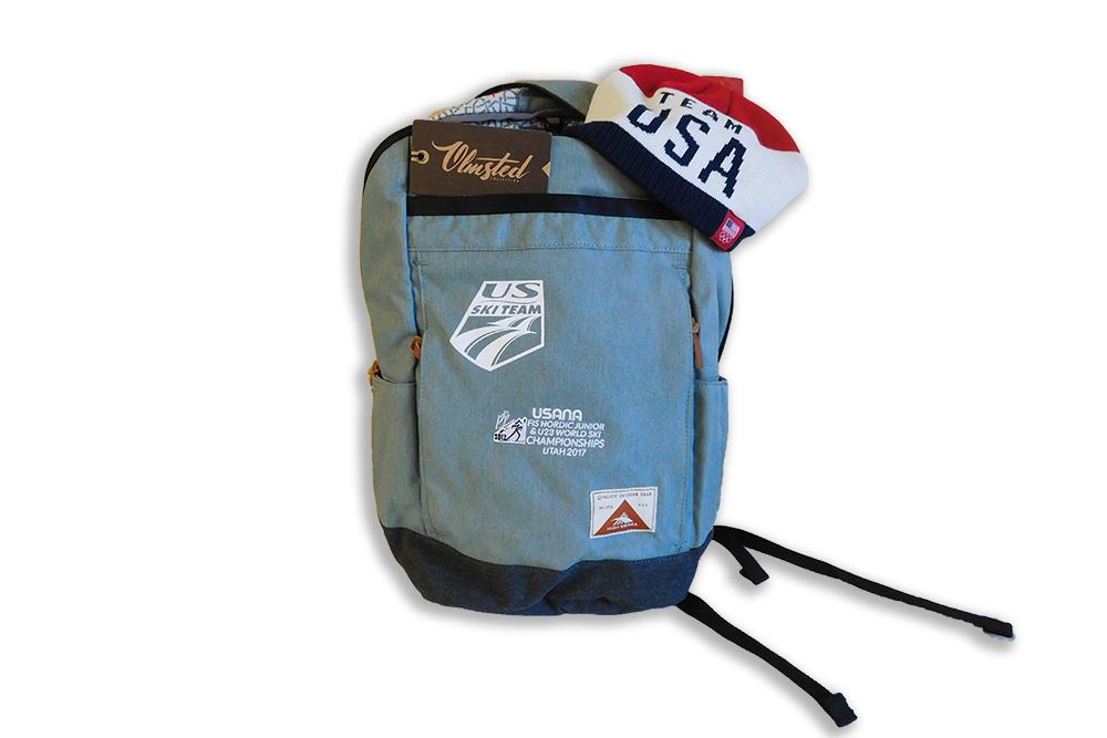 blue backpack with US Ski Team beanie hat