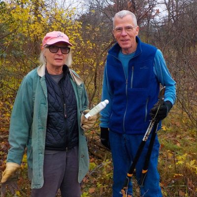 Two friends members work on buckthorn removal