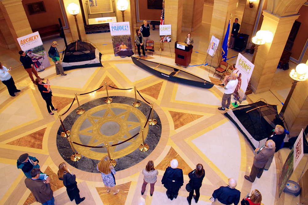 "Aerial view of the state capitol rotunda filled with banners about ""I Can"" programs"