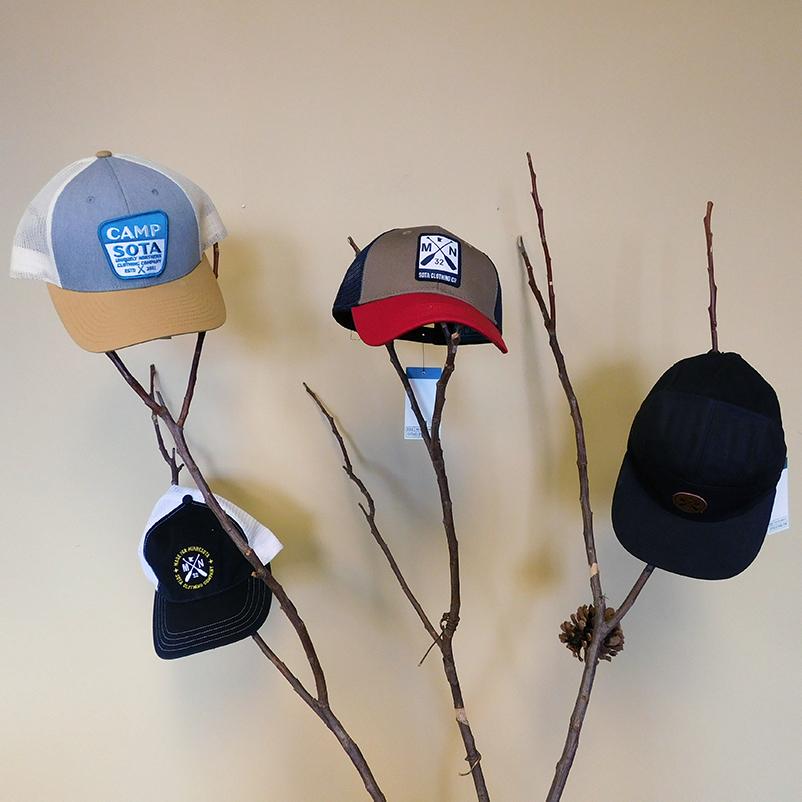 four Sota branded caps