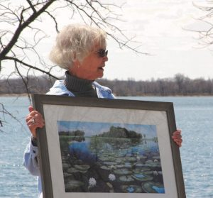 Grace poses with her award, a landscape print