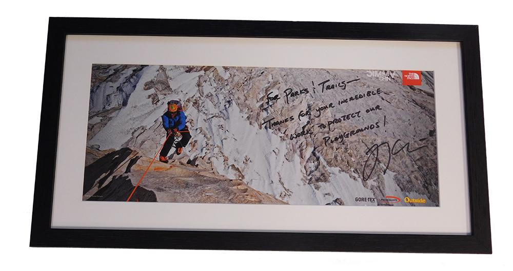 framed poster of mountain climber