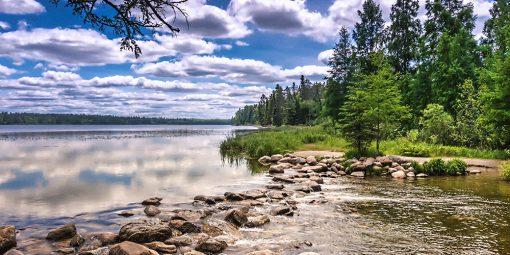 Rock strewn across lake at the headewaters
