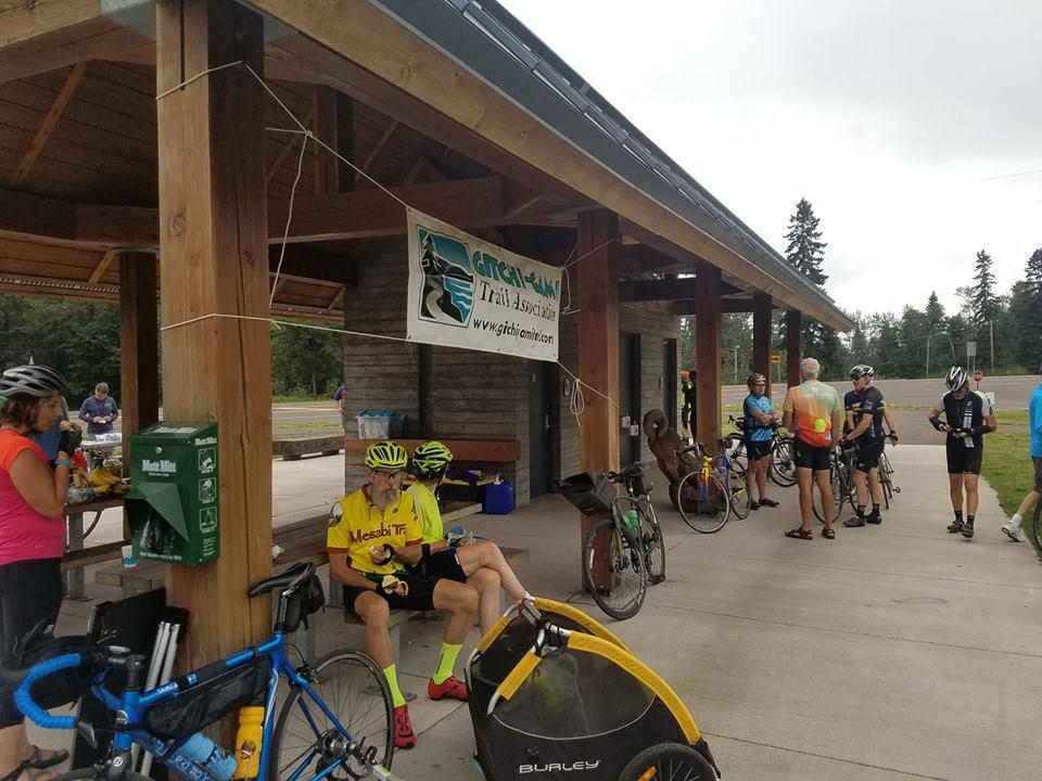 Bikers rest at a shelter building