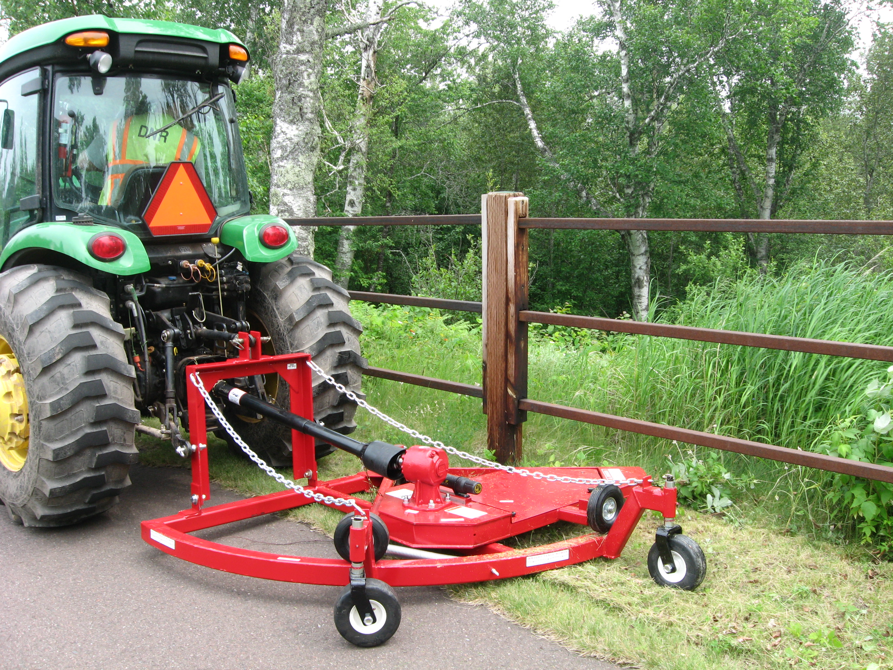 Lawn mower attachment on a tractor