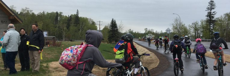 Kids take off by bike on the newly opened paved trail