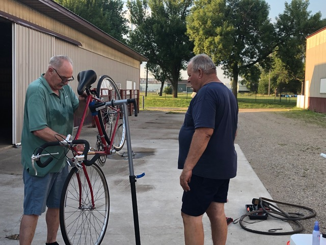 Man adjusts bike on a stand