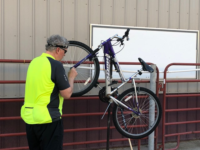 Man adjusts bike