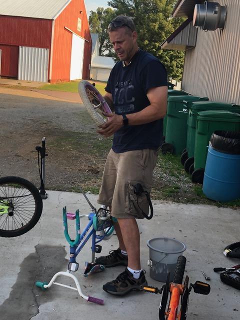 Man changes bike tires