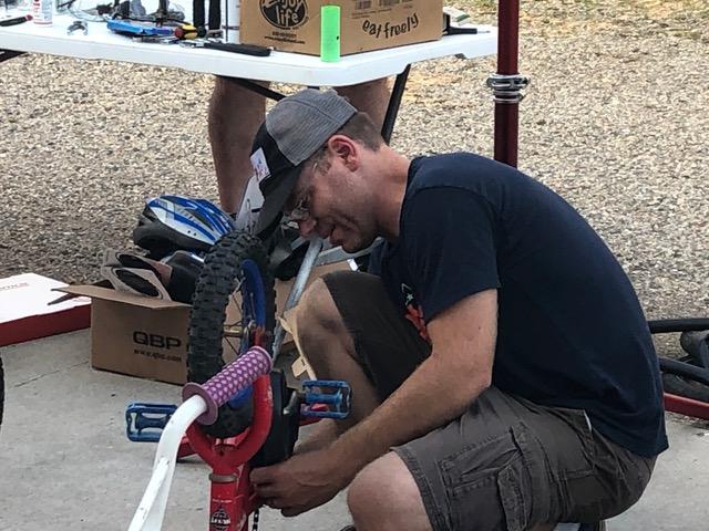 Man replacing bike chain