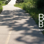 Border Bike Ride banner with trail