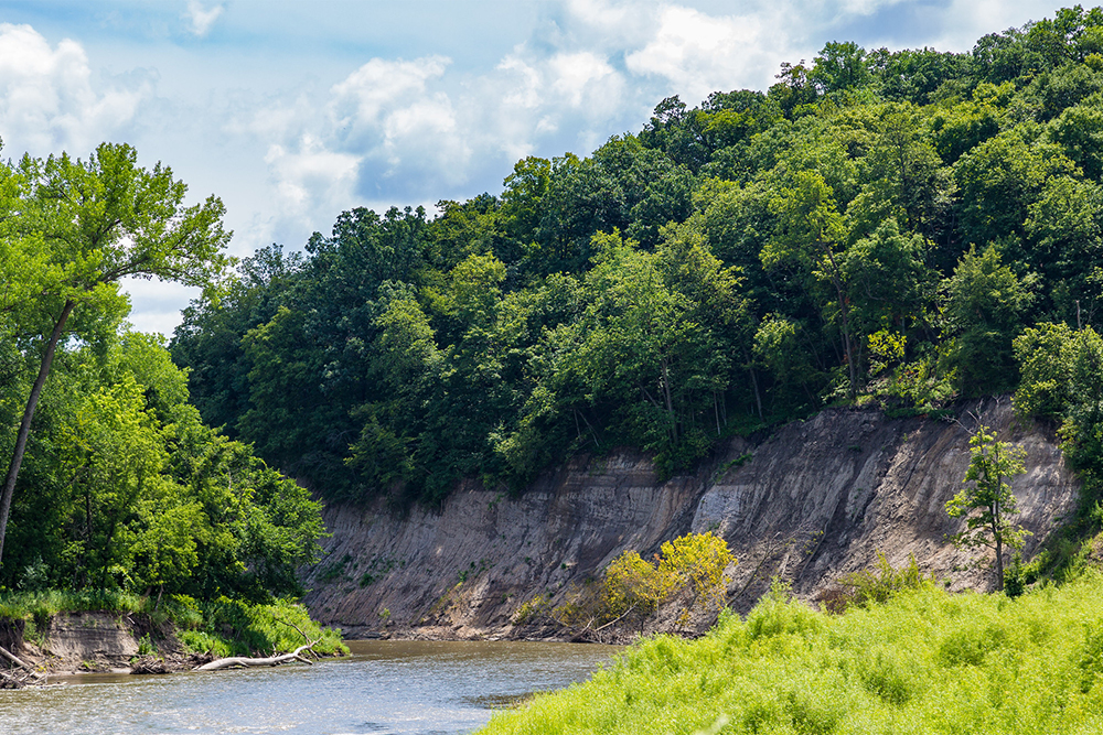 River bordered by washedout cliff