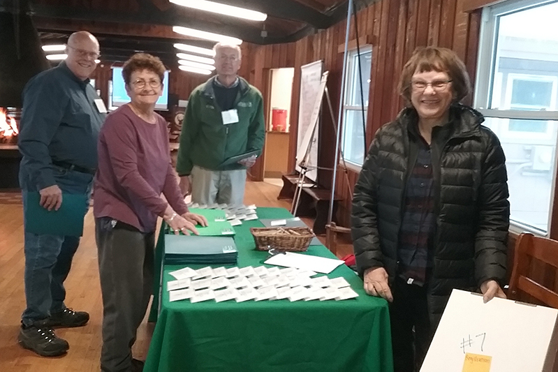 volunteers setting up the registration table