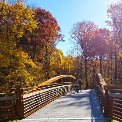 two bicyclists on trail bridge