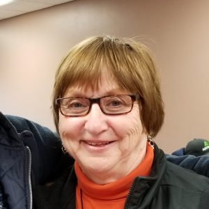profile picture of woman with glasses
