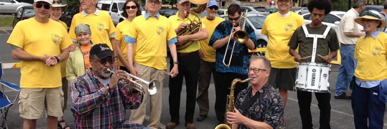 Brass band playing in parking lot