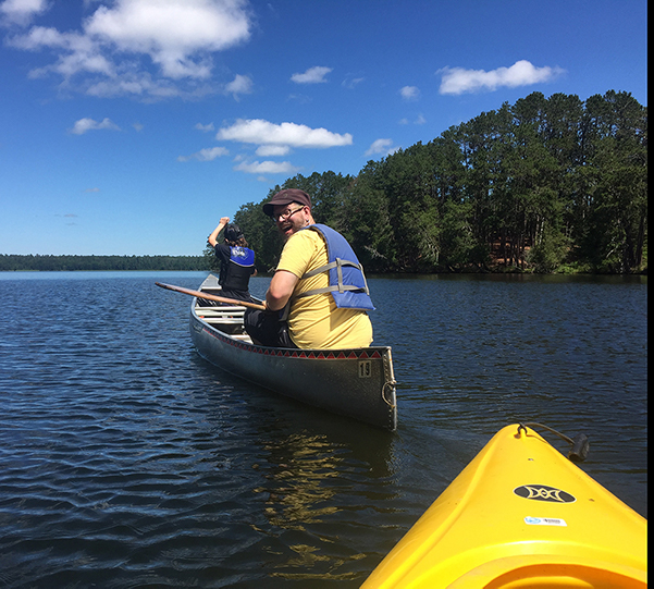 Two people in canoe on lake