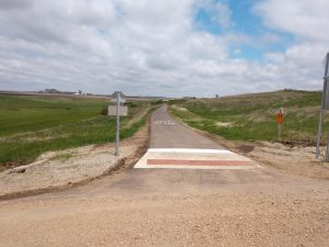 new paved trail segment with fields on each side