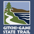 logo with a tree, trail, and water