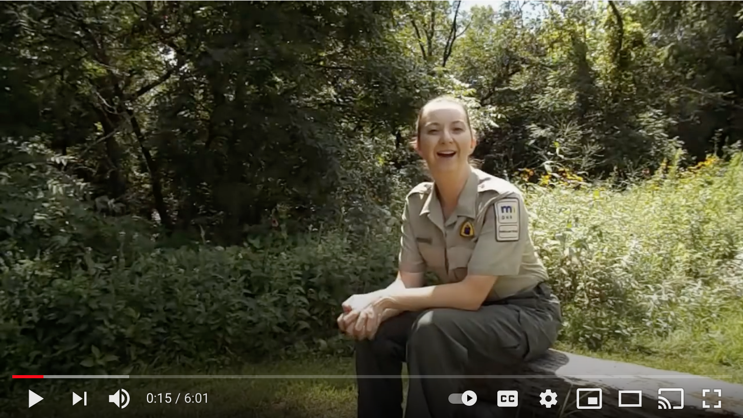 park ranger speaking outside in screenshot of video