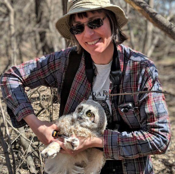 woman branding an owlet