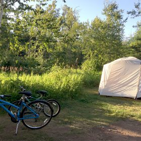 tent and bikes at a campsite