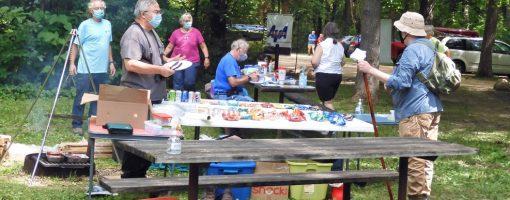 walkers practicing social distancing at food break
