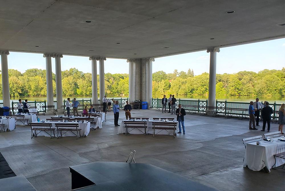 Inside a large, concrete pavilion