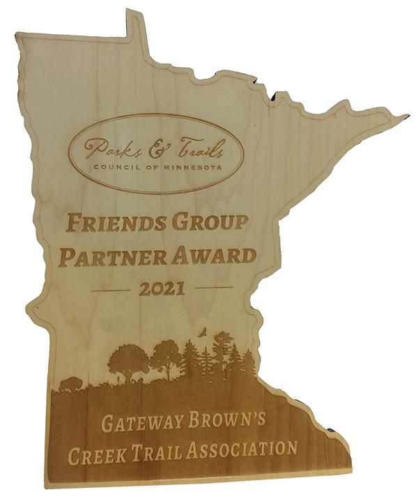 Wooden award in shape of Minnesota