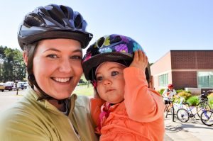 Mom and child with bike helmets