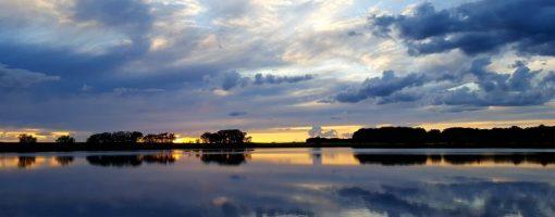 "Appropriately named ""Sunset Lake"" in Glendalough State Park. By Lisa Malmstrom"
