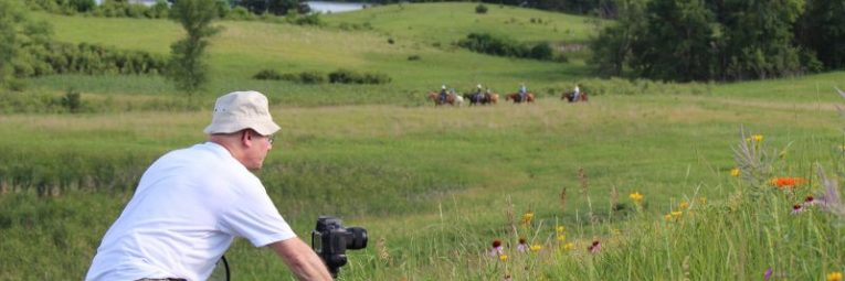 photographer and horseback riders