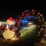 Snowman and lighted arch for winter event