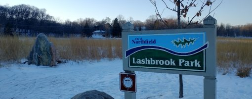 Lashbrook park sign with snow on the ground