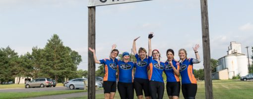 group of riders under the St. Joseph sign