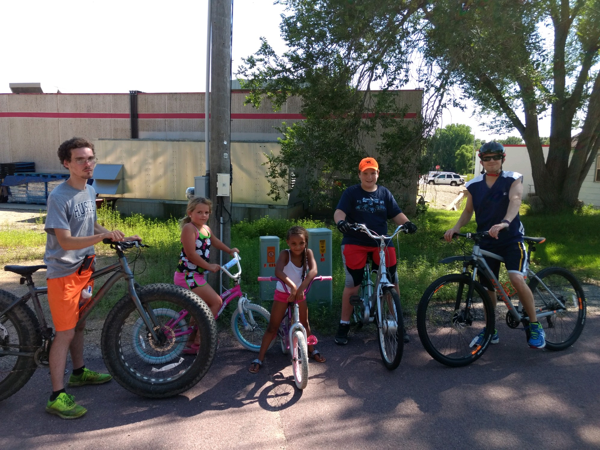 Kids pose for a picture on their bikes