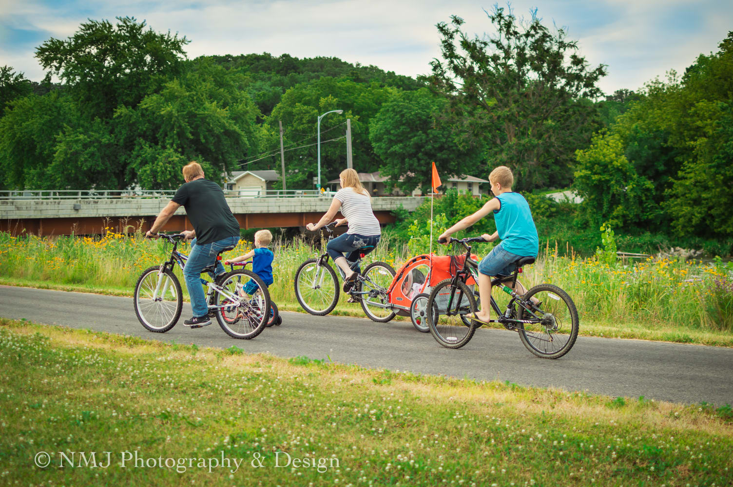 A family of bikers heads down the trail