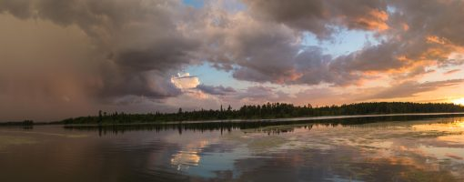 Sunset at Itasca with a storm rolling to the south and east. By Benjamin Anderson