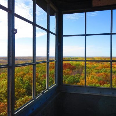 looking through fire tower at autumn leaves