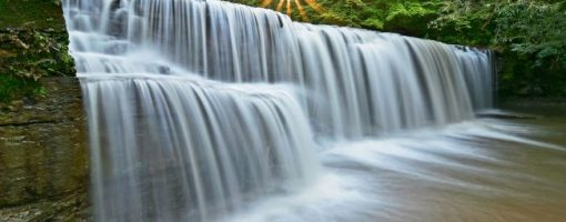 waterfalls with sun beams