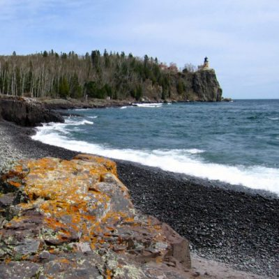 shore of lake superior and lighthouse